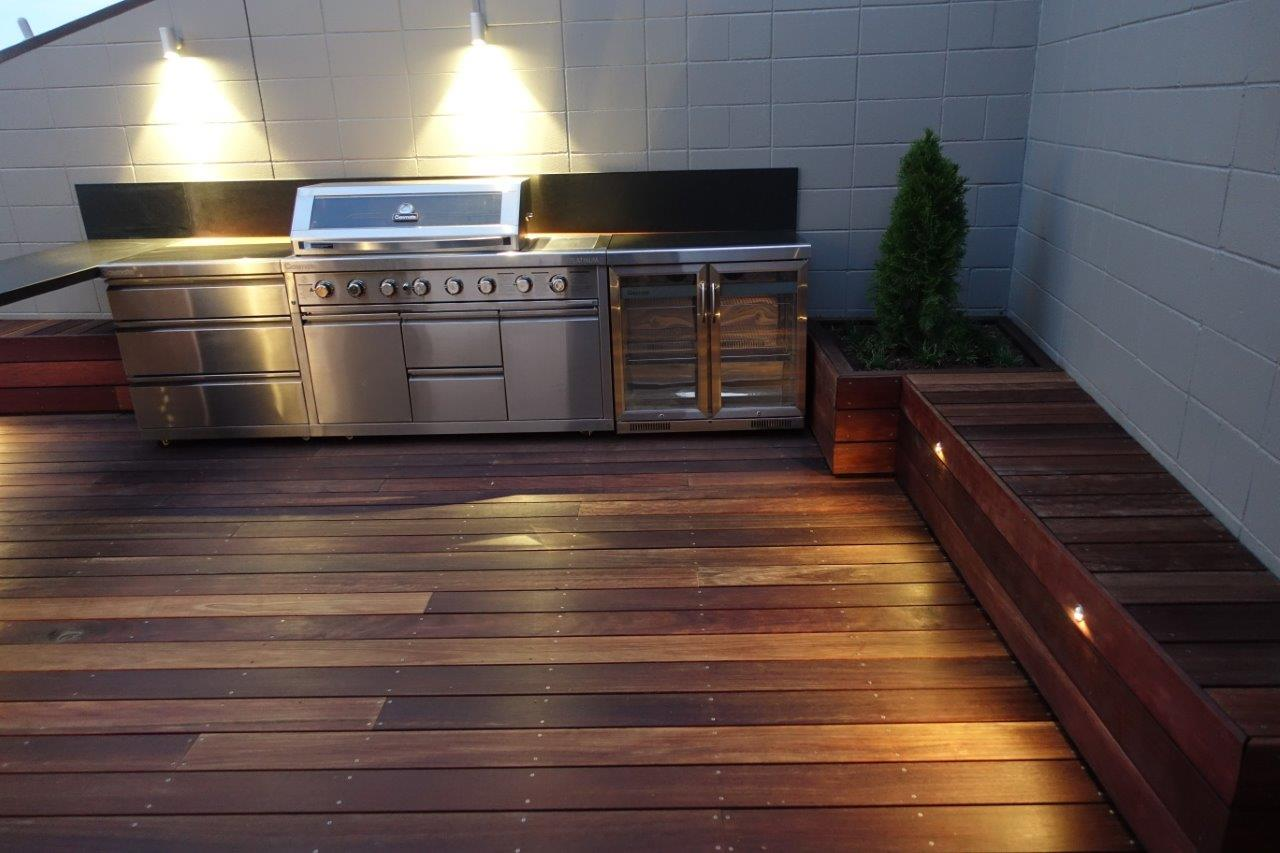 Landscape outdoor living area with bbq and deck