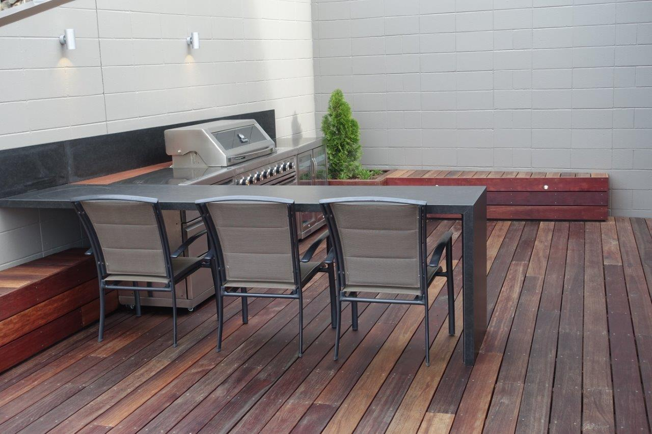 Outdoor BBQ are with kitchen and deck