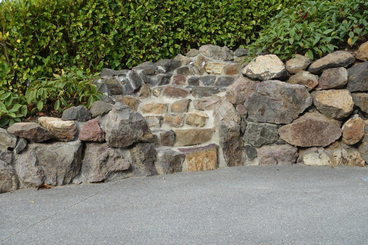 Rock Steps on top of exposed aggregate concrete