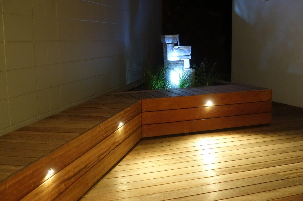 Deck with raised seat with landscaping planter box